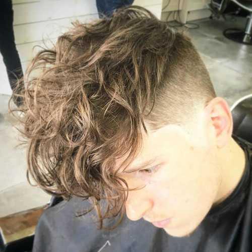 pelusa del corte de pelo para los hombres